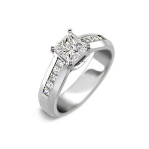 image of 31-9185 ENGAGEMENT RING WITH SIDE STONES_ROUND CUT CENTRE DIAMOND CHANNEL SET SIDE STONES