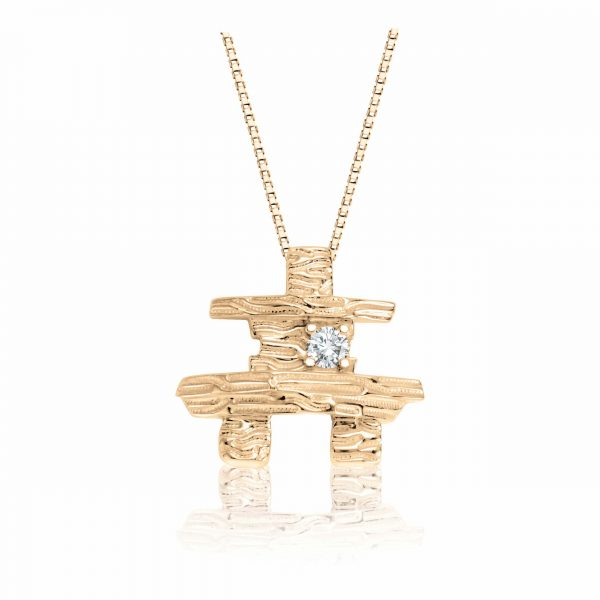 "Inukshuk pendant, Nice detail, Special design high polished, Set with a dazzling diamond of 0.08Ct. weight, Includes 18"" long chain. Available in white or yellow gold."